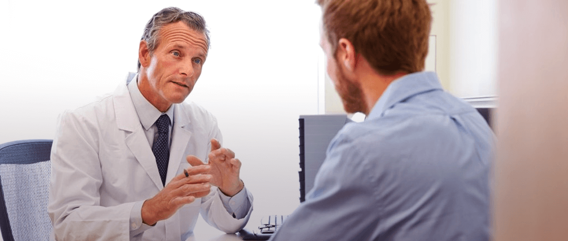 doctor calmly explaining situation to the patient